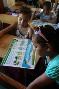 Students in Weno, Chuuk with the PCEP High and Low Island Environment Posters, July 2015